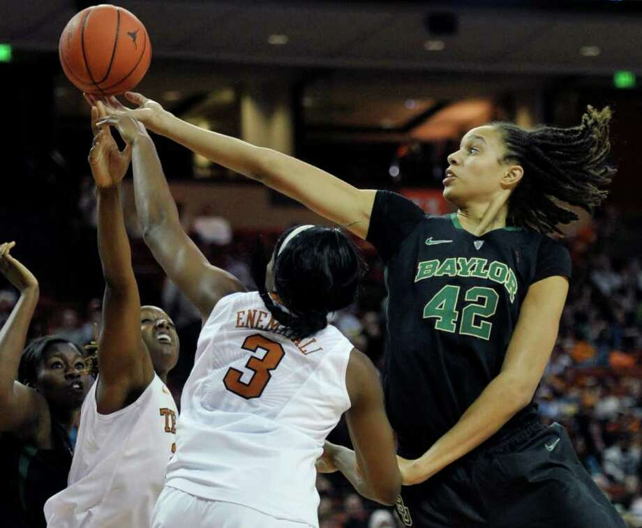 Brittney Griner's reach advantage serves her well in  pulling a rebound away from Texas' Nneka Enemkpali, center,  and Ashley Gale. Photo: Michael Thomas / FR65778 AP