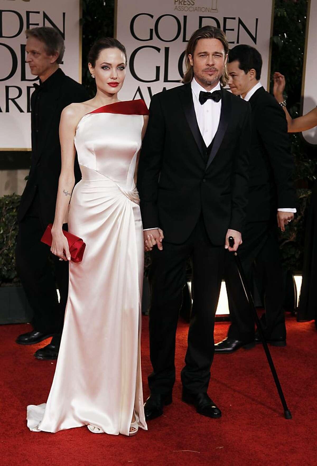 Angelina Jolie, left, and Brad Pitt arrive at the 69th Annual Golden Globe Awards Sunday, Jan. 15, 2012, in Los Angeles. (AP Photo/Matt Sayles)