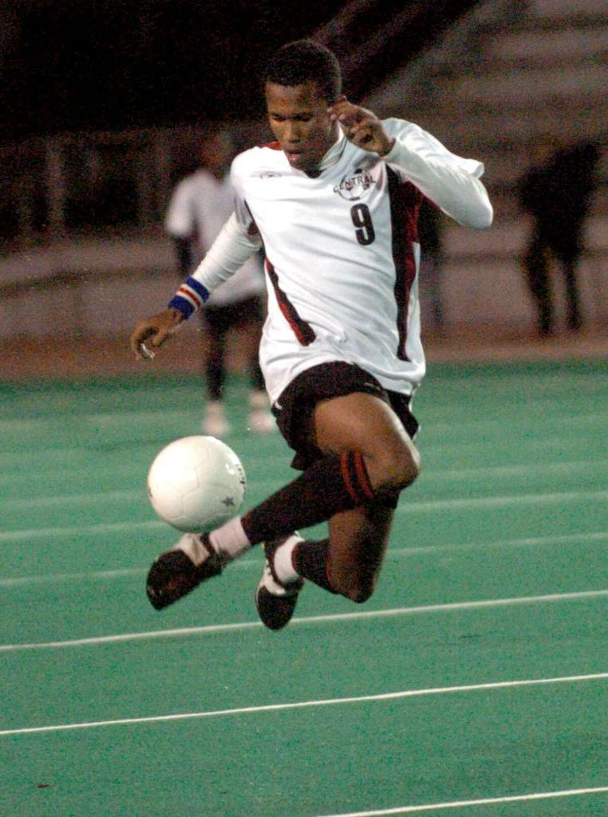 Central's # Mickelvin Lopes uses some fancy footwork to guide the ball, during FCIAC soccer action against Staples in Bridgeport, Conn. on Wednesday Oct. 28, 2009. McLauren scored both of the teams goals. Central beat Staples 2-0.