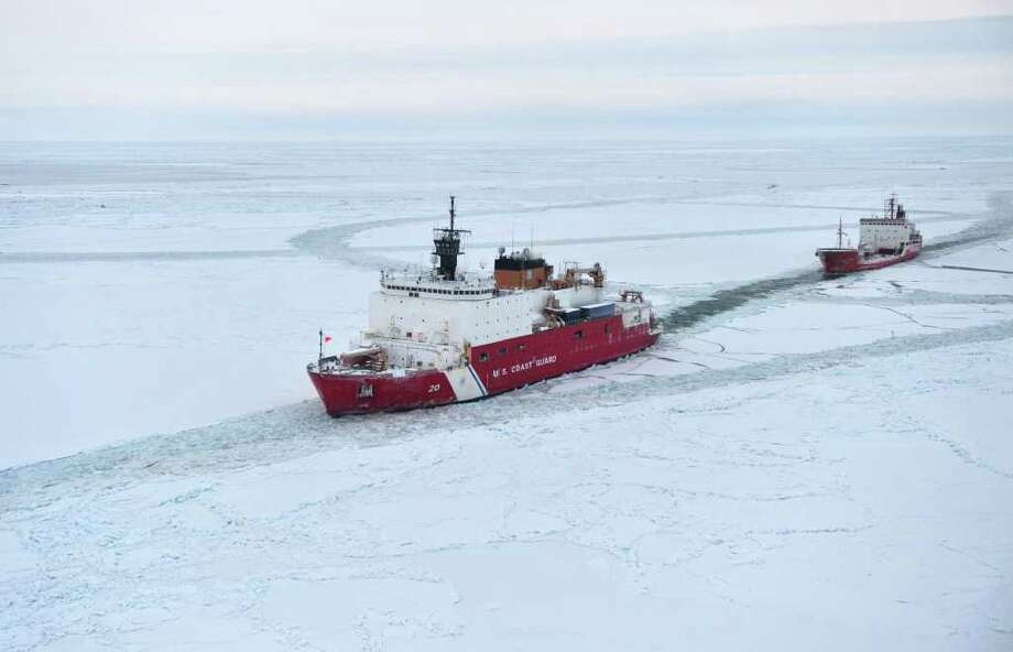 The Coast Guard icebreaker Healy escorts the Russian tanker Renda, filled with fuel for Nome, Alaska, as the ships near the city after a long, frozen journey. Photo: HO / AFP