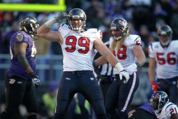 Texans defensive end J.J. Watt celebrates after a stop on Baltimore Ravens quarterback Joe Flacco during the second quarter.