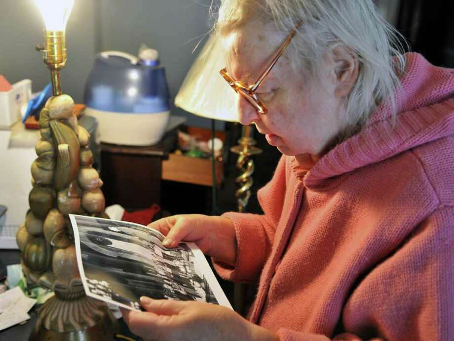 Diane Van Wie, longtime personal secretary of NYS Gov. Nelson Rockefeller, looks over old photographs from those days at her Albany home Wednesday Jan. 11, 2012.  (John Carl D'Annibale / Times Union) Photo: John Carl D'Annibale / 00016065A