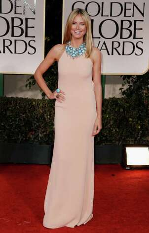 Heidi Klum arrives at the 69th Annual Golden Globe Awards Sunday, Jan. 15, 2012, in Los Angeles. Photo: Associated Press