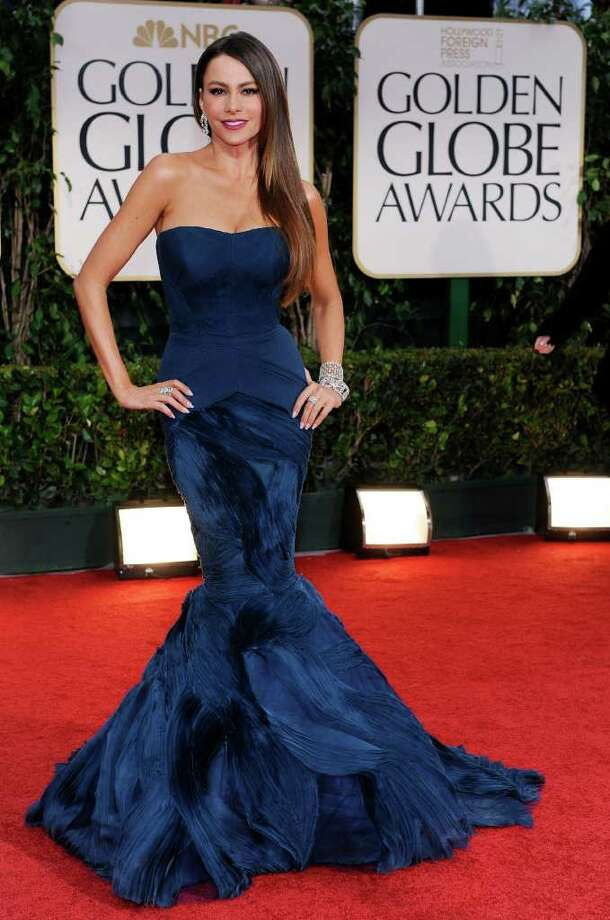 """Curves ahead: Sofia Vegara was a sexy Hollywood siren in her Vera Wang mermaid gown with a fish tail and Harry Winston drop diamond earrings. She called it her """"zip and close"""" dress. Photo: Associated Press"""