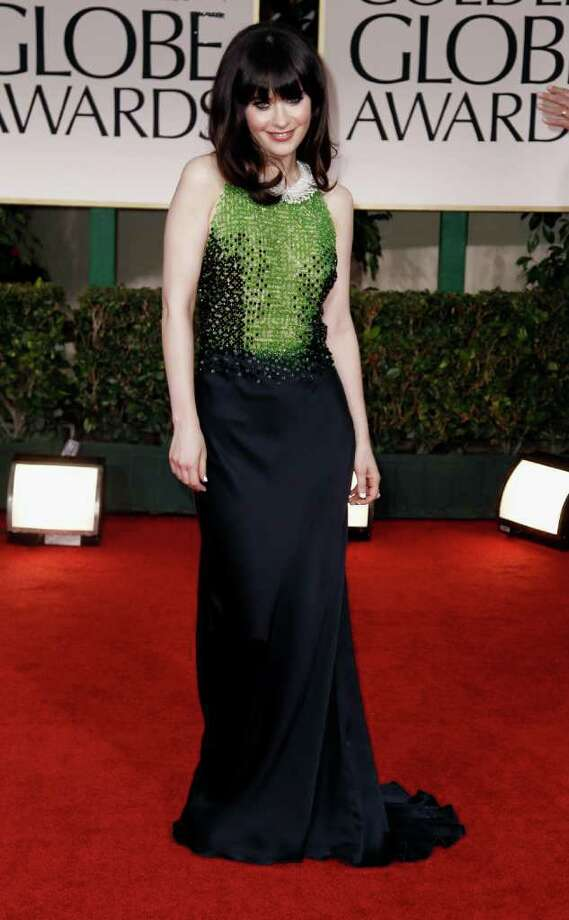 Zooey Deschanel arrives at the 69th Annual Golden Globe Awards Sunday, Jan. 15, 2012, in Los Angeles. Photo: Associated Press