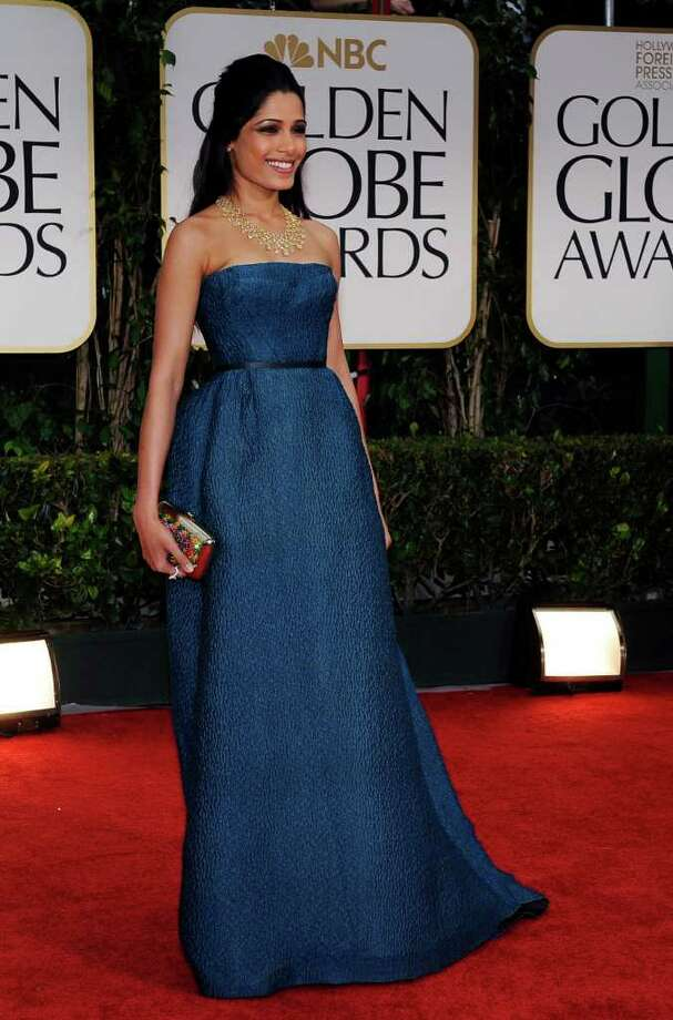 The boring blues: Freida Pinto said she wore this yawn gown, a custom Prada, because she liked the fabric. Listen up Freida: I like the fabric on my bedspread, but I'm not gonna have it turned into a vested suit.  Photo: Associated Press