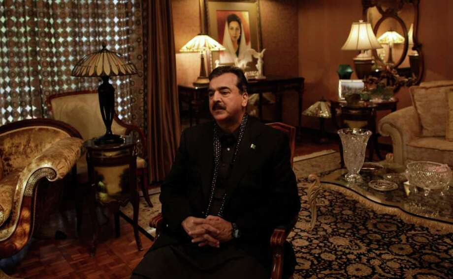 In this Monday, Oct. 5, 2011 photo, Pakistani Prime Minister Yousuf Raza Gilani pauses during an interview with the Associated Press at his residence in Lahore, Pakistan. A political crisis gripping Pakistan could take a decisive turn Monday when its embattled government appears before the Supreme Court, which is ordering it to reopen a stalled graft probe against the president or face dismissal. (AP Photo/Muhammed Muheisen) Photo: Muhammed Muheisen / AP