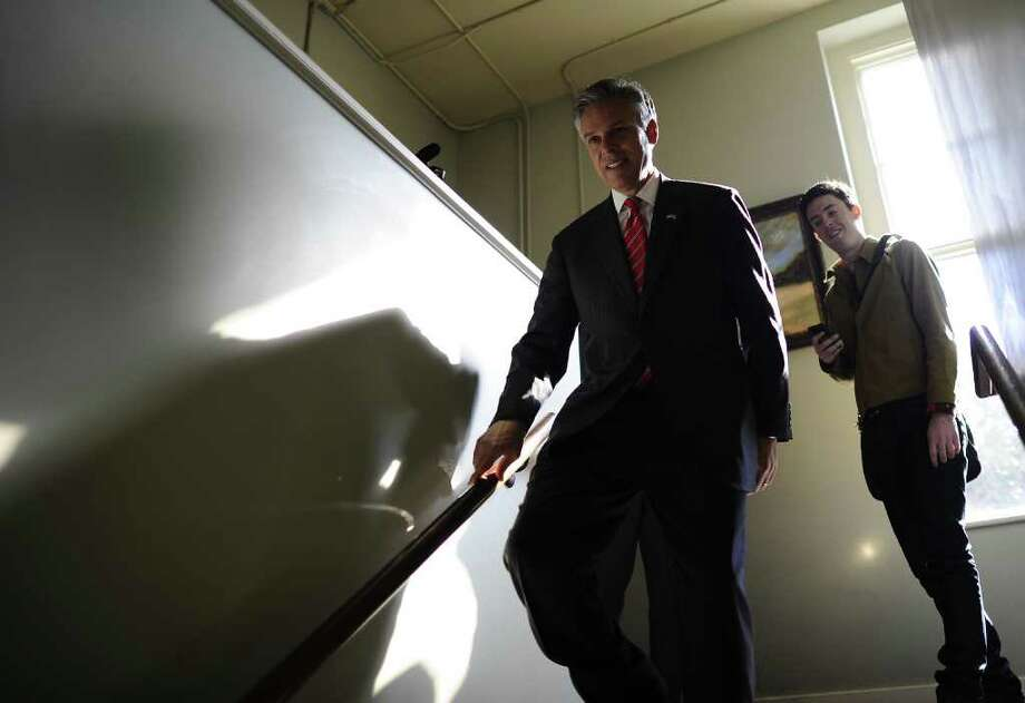 Republican presidential hopeful Jon Huntsman walks down a stair case after greeting people at Virginia's restaurant in Charleston, South Carolina, January 15, 2012. South Carolina will hold its Republican primary on January 21, 2012.  AFP PHOTO/Emmanuel Dunand Photo: EMMANUEL DUNAND, AFP/Getty Images / 2012 AFP