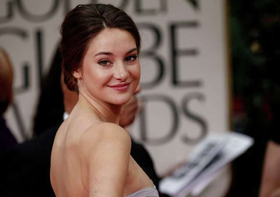 """The Iridescent"": Shailene Woodley of ""The Descendants"" is pretty in an ethereal, iridescent art-deco gown by Marchesa. It featured a sheer overlay that revealed the bling underneath. Photo: AP"