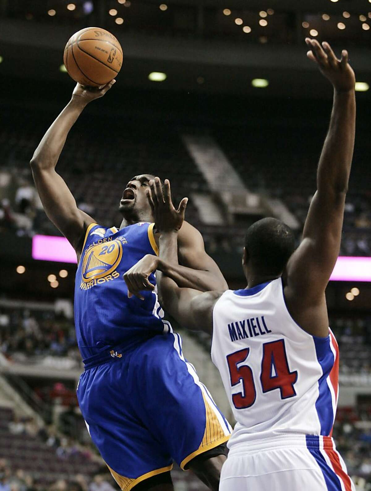 Golden State Warriors' Ekpe Udoh (20) is fouled by Detroit Pistons' Jason Maxiell (54) while taking a shot in the first half of an NBA basketball game Sunday, Jan. 15, 2012, in Auburn Hills, Mich.