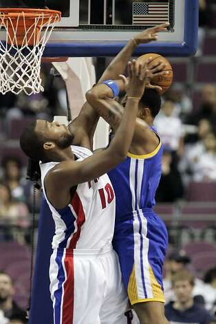 Detroit Pistons' Greg Monroe (10) blocks a shot by Golden State Warriors' Brandon Rush in the second half of an NBA basketball game Sunday, Jan. 15, 2012, in Auburn Hills, Mich. The Warriors defeated the Pistons 99-91. (AP Photo/Duane Burleson) Photo: Duane Burleson, Associated Press