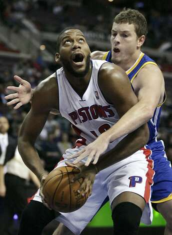 Detroit Pistons' Greg Monroe, left, looks for a shot against Golden State Warriors' David Lee in the second half of an NBA basketball game Sunday, Jan. 15, 2012, in Auburn Hills, Mich. Lee led the Warriors with 24 points in a 99-91 win. (AP Photo/Duane Burleson) Photo: Duane Burleson, Associated Press