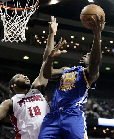 Golden State Warriors' Charles Jenkins (22) takes a shot against Detroit Pistons' Greg Monroe in the first half of an NBA basketball game Sunday, Jan. 15, 2012, in Auburn Hills, Mich. (AP Photo/Duane Burleson) Photo: Duane Burleson, Associated Press