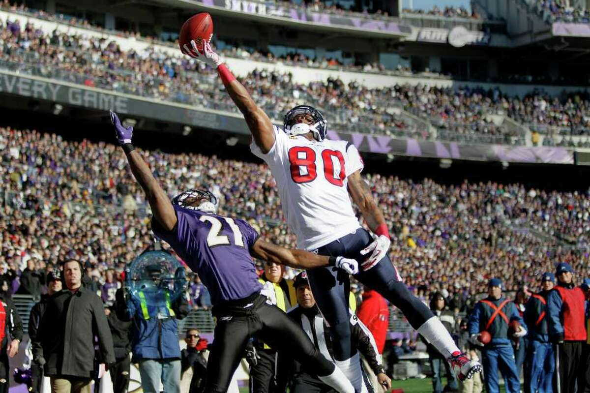 Texans receiver Andre Johnson (80) can't quite pull in a catch over Ravens cornerback Lardarius Webb (21) in the second quarter Sunday at M&T Bank Stadium in Baltimore. The Texans had four turnovers as their season ended just shy of the AFC title game.