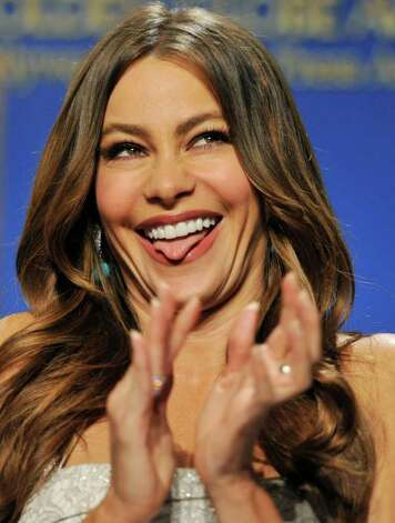 "Presenter Sofia Vergara reacts onstage after she was nominated for Best Performance by an Actress in a Supporting Role in a Series, Mini-Series or Motion Picture Made for Television for ""Modern Family,"" during nominations for the 69th Annual Golden Globe Awards, Thursday, Dec. 15, 2011, in Beverly Hills, Calif. The Golden Globe Awards will be held on Sunday, Jan. 15, 2012, in Beverly Hills, Calif. Photo: AP"