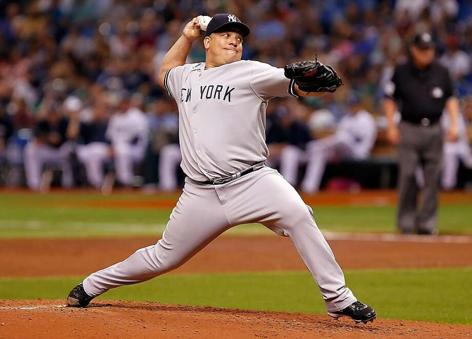 ST PETERSBURG, FL - SEPTEMBER 27: Pitcher Bartolo Colon #40 of the New York Yankees pitches against the Tampa Bay Rays during the game at Tropicana Field on September 27, 2011 in St. Petersburg, Florida. (Photo by J. Meric/Getty Images)  ST PETERSBURG, FL - SEPTEMBER 27:  Pitcher Bartolo Colon #40 of the New York Yankees pitches against the Tampa Bay Rays during the game at Tropicana Field on September 27, 2011 in St. Petersburg, Florida.  (Photo by J. Meric/Getty Images) Photo: J. Meric, Getty Images