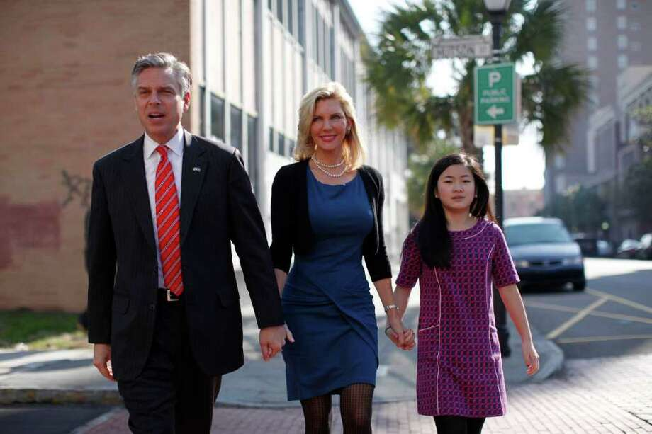 Republican presidential candidate former Utah Gov. Jon Huntsman, his wife Mary Kaye and daughter Gracie, 12, arrive at a campaign stop at Virginia's on King restaurant, Sunday, Jan. 15, 2012, in Charleston, S.C. (AP Photo/Matt Rourke) Photo: Matt Rourke