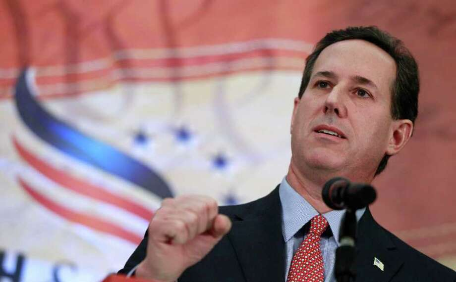 Republican presidential candidate, former Sen. Rick Santorum, R-Pa., speaks as he campaigns at the Faith and Freedom Coalition Prayer Breakfast in Myrtle Beach, S.C., Sunday, Jan. 15, 2012. (AP Photo/Charles Dharapak) Photo: Charles Dharapak