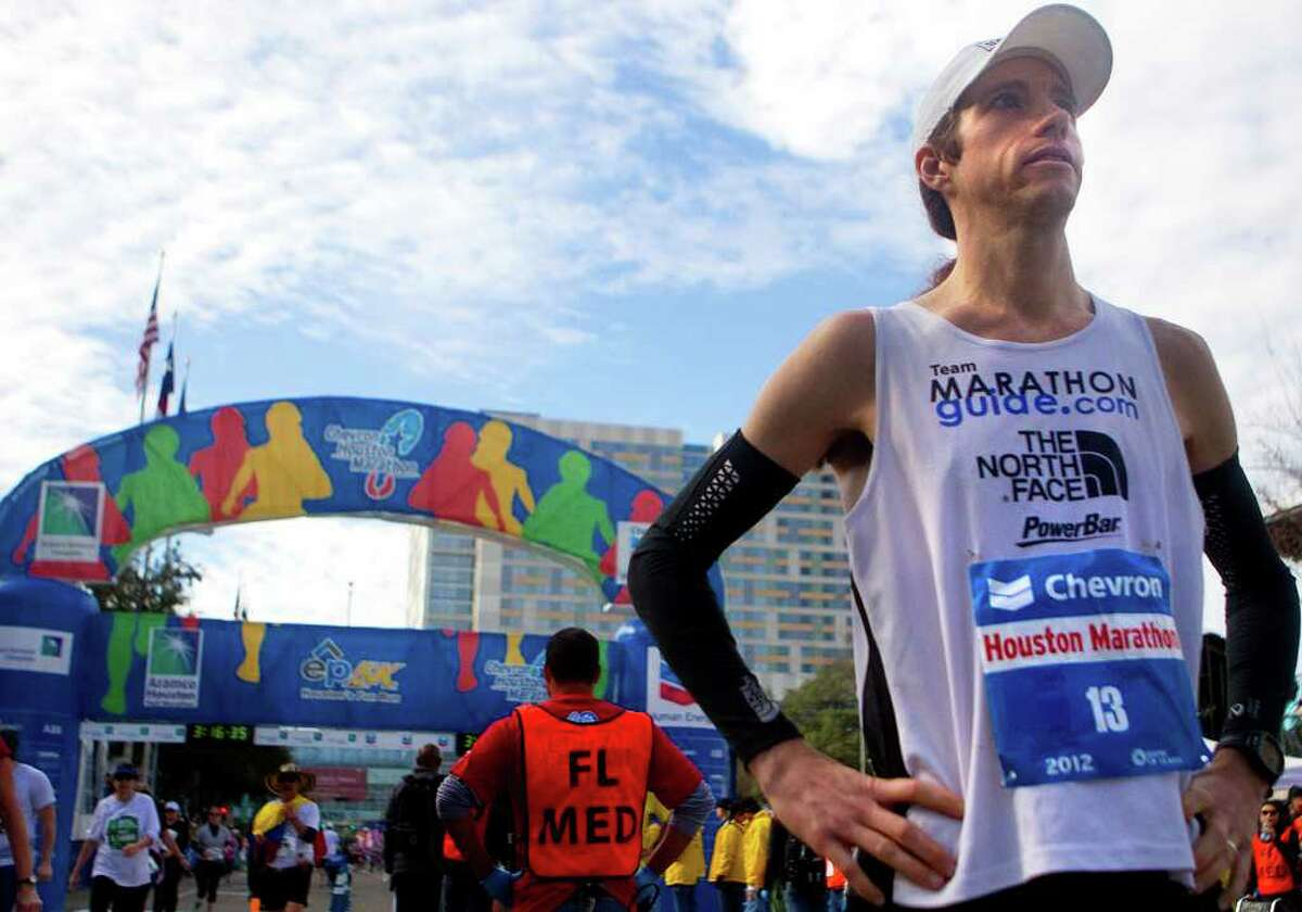 Mike Wardian catches his breath after finishing his second marathon in two days Sunday.