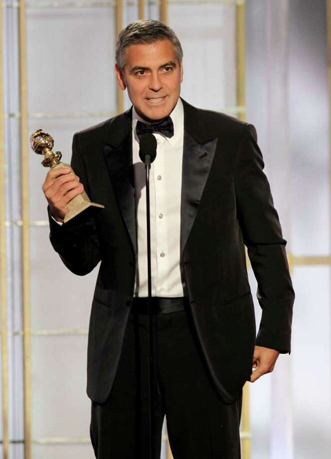 "George Clooney accepts the award for best actor for his role in ""The Descendants"" during the 69th Annual Golden Globe Awards on Sunday in Los Angeles. Photo: ASSOCIATED PRESS"