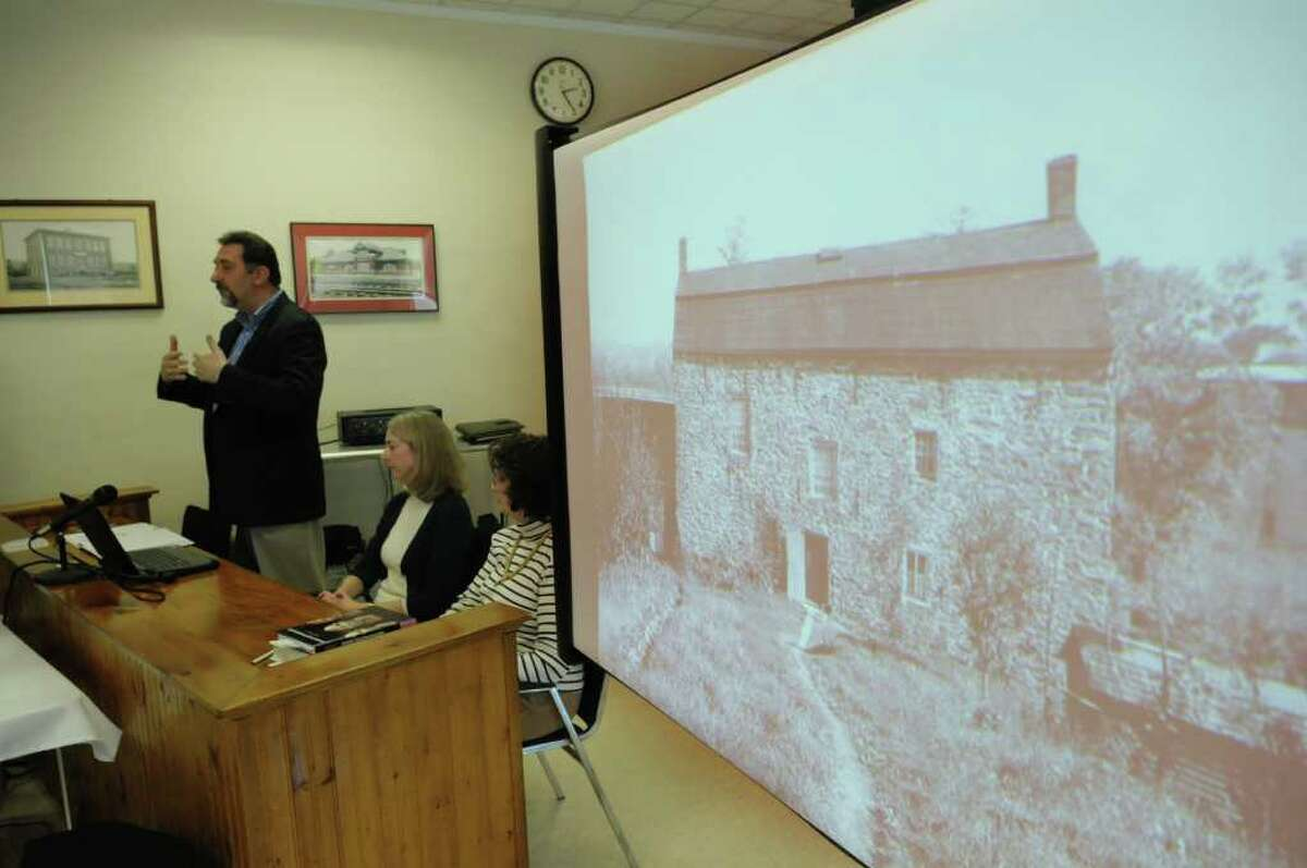 John Bonafide, far left, addresses those gathered at the Ravena Village Hall on Sunday, Jan. 15, 2012 in Ravena, NY. as a photograph of the Coeymans Manor Home is seen on the screen. In May 2008, a contractor at the historic Coeymans house found a woman's skull while working on a basement wall and on Sunday researchers spoke to the public on their best guesses of who the person was. (Paul Buckowski / Times Union)