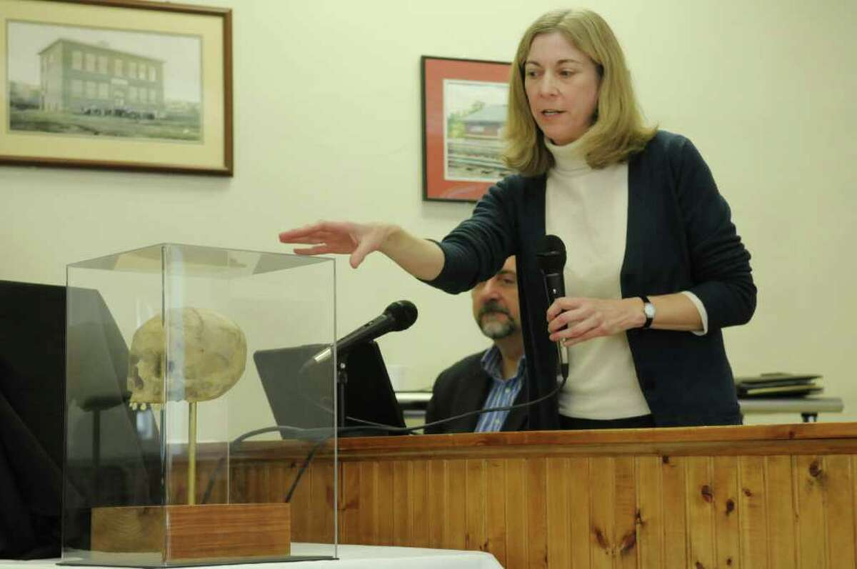 Lisa Anderson, with the New York State Museum, talks about a skull during a presentation at the Ravena Village Hall on Sunday, Jan. 15, 2012 in Ravena, NY. In May 2008, a contractor at the historic Coeymans Stone House found a woman's skull while working on a basement wall and on Sunday researchers spoke to the public on their best guesses of who the person was. (Paul Buckowski / Times Union)