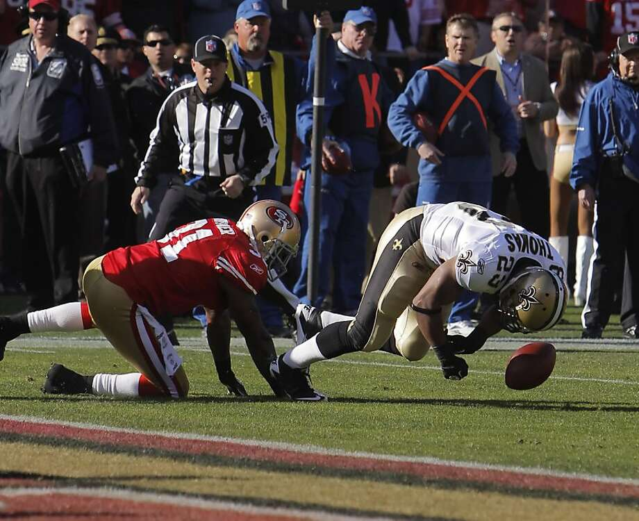 Pierre Thomas fumbles the ball after getting hit by Donte Whitner in the first quarter. The 49ers recovered the fumble. The San Francisco 49ers played the New Orleans Saints in the NFC Divisional playoff game at Candlestick Park in San Francisco, Calif., on Saturday, January 14, 2012. Photo: Carlos Avila Gonzalez, The Chronicle