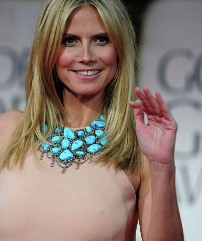 Model Heidi Klum wore a statement turquoise necklace. Photo: FREDERIC J. BROWN / AFP