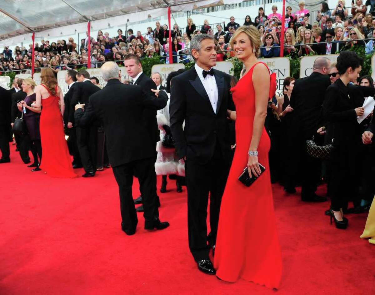 Who to gawk at first with this golden couple? The always-suave George Clooney, or his date, Stacy Keibler, who was stunning in a form-fitting red Valentino gown.