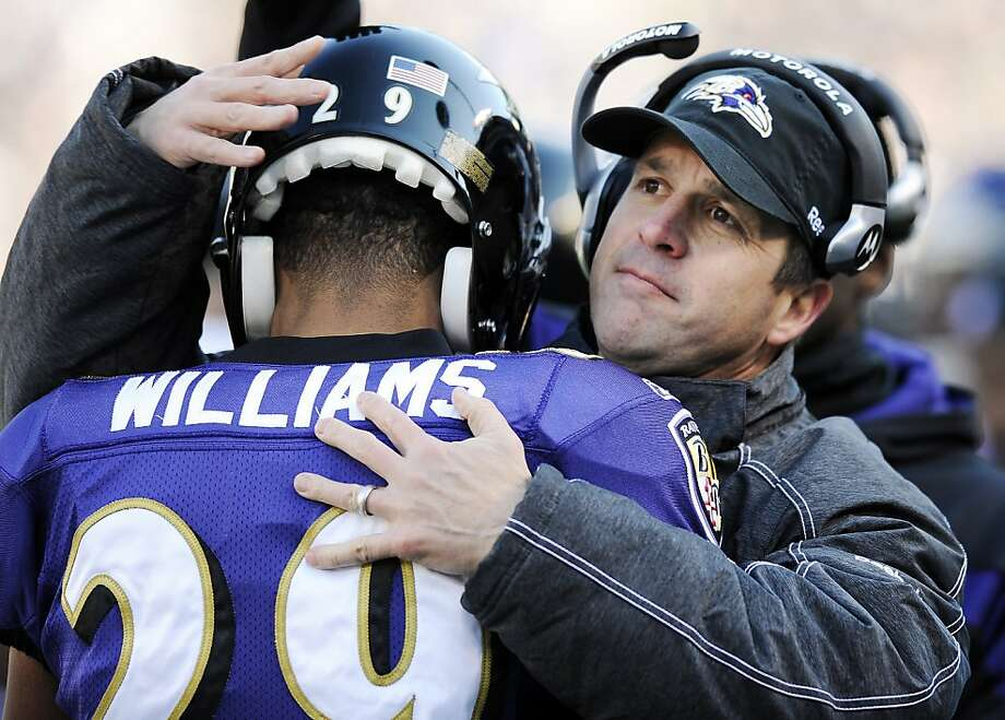 Baltimore Ravens head coach John Harbaugh hugs cornerback Cary Williams during the first half of an NFL divisional playoff football game against Houston Texans in Baltimore, Sunday, Jan. 15, 2012. (AP Photo/Nick Wass) Photo: Nick Wass, Associated Press