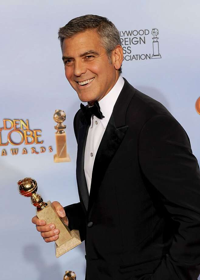 "BEVERLY HILLS, CA - JANUARY 15:  Actor George Clooney poses in the press room with the Best Performance by an Actor in a Motion Picture - Drama  award for ""The Descendants"" at the 69th Annual Golden Globe Awards held at the Beverly Hilton Hotel on January 15, 2012 in Beverly Hills, California.  (Photo by Kevin Winter/Getty Images) Photo: Kevin Winter, Getty Images"