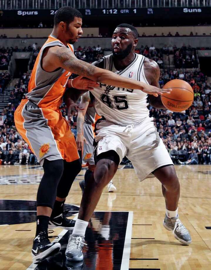 San Antonio Spurs' DeJuan Blair looks for room around Phoenix Suns' Markieff Morris during first half action Sunday Jan. 15, 2012 at the AT&T Center. Photo: EDWARD A. ORNELAS, Express-News / SAN ANTONIO EXPRESS-NEWS (NFS)