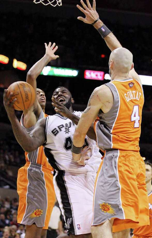 San Antonio Spurs' DeJuan Blair looks for room between Phoenix Suns' Channing Frye  and  Phoenix Suns' Marcin Gortat during second half action Sunday Jan. 15, 2012 at the AT&T Center. The Spurs won 102-91. Photo: EDWARD A. ORNELAS, Express-News / SAN ANTONIO EXPRESS-NEWS (NFS)
