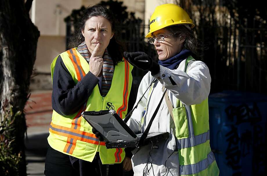 Urban Forester Carla Short (left) and arborist Wendy Wilkins consult about a tree on Broad Street in San Francisco, Calif. With a dwindling budget, San Francisco's Dept. of Public Works plans to hand over the care of thousands of trees to residents who live nearby. A group of arborists are currently inspecting the health of the trees. Photo: Brant Ward, The Chronicle