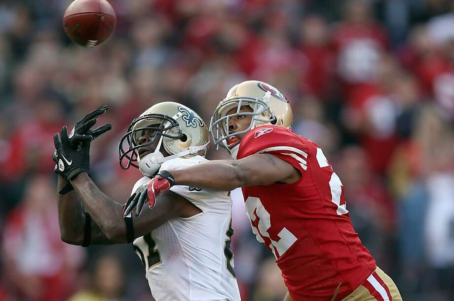 SAN FRANCISCO, CA - JANUARY 14:  Carlos Rogers #22 of the San Francisco 49ers forces an incomplete pass against Adrian Arrington #87 of the New Orleans Saints during the third quarter of the NFC Divisional playoff game at Candlestick Park on January 14, 2012 in San Francisco, California.  (Photo by Jed Jacobsohn/Getty Images) Photo: Jed Jacobsohn, Getty Images