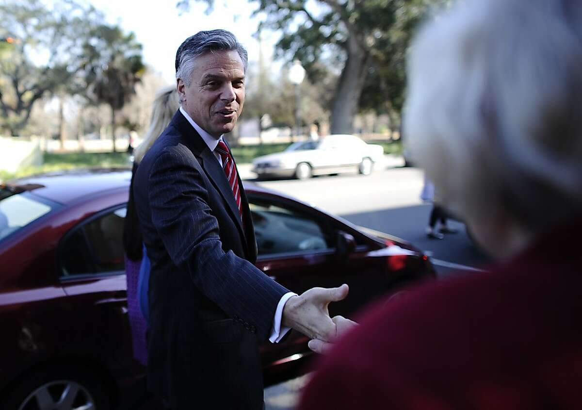 Republican presidential hopeful Jon Huntsman greets people outside Virginia's restaurant in Charleston, South Carolina, January 15, 2012. South Carolina will hold its Republican primary on January 21, 2012. AFP PHOTO/Emmanuel Dunand (Photo credit should read EMMANUEL DUNAND/AFP/Getty Images)