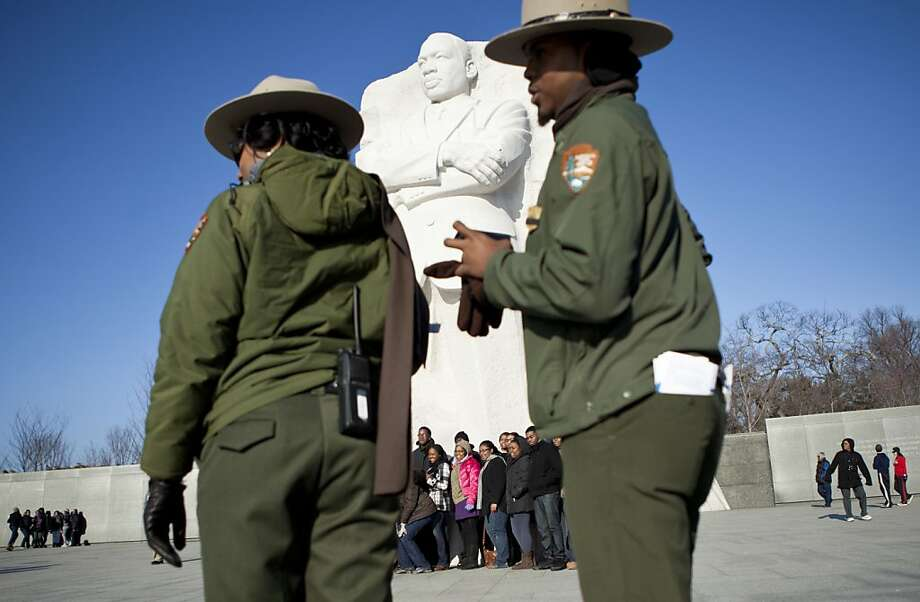 WASHINGTON, DC - JANUARY 15:  People pose at the Martin Luther King Jr. memorial on the National Mall January 15, 2012 in Washington, DC.  Martin Luther King III and others joined to lay a wreath at the memorial to Rev. Dr. Martin Luther King Jr. to honor the 83rd birthday of the American Civil Rights leader who was assassinated in 1968.  (Photo by Brendan Smialowski/Getty Images) Photo: Brendan Smialowski, Getty Images