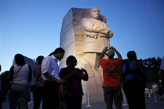 People visit the Martin Luther King, Jr. Memorial in Washington, on Tuesday, Aug. 23, 2011. (AP Photo/Jacquelyn Martin) Photo: Jacquelyn Martin, Associated Press