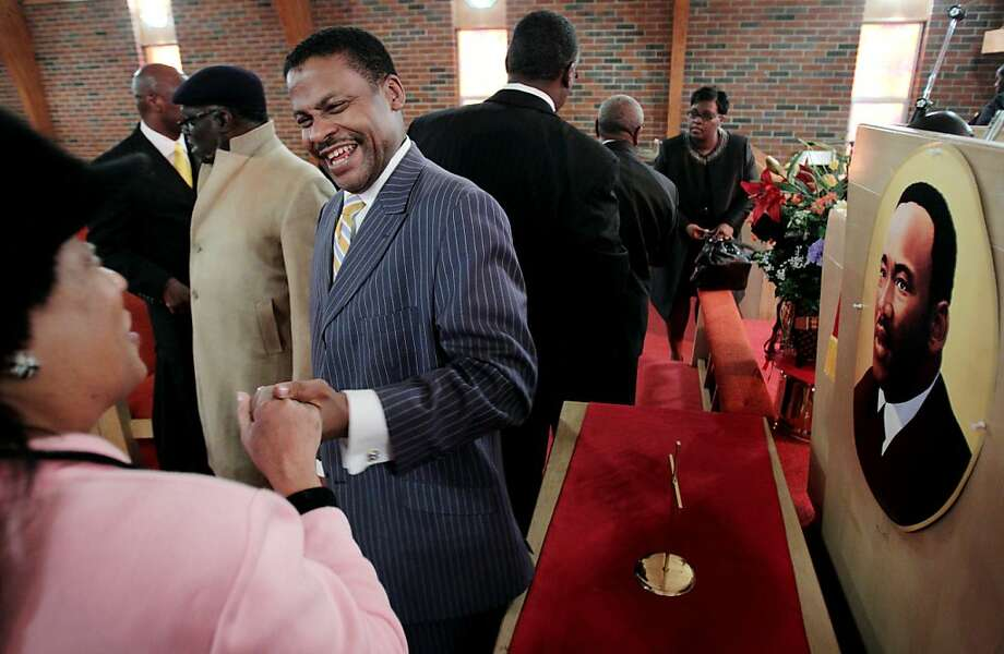 Isaac Newton Farris Jr., nephew of Dr. Martin Luther King Jr. and current national president of the Southern Christian Leadership Council, shakes the hand of Patricia Rogers following the Sunday service commemorating Dr. King's birthday at Annesdale Cherokee Missionary Baptist Church. (AP Photo/The Commercial Appeal, Mike Brown) Photo: Mike Brown, Associated Press