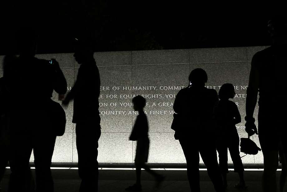 People visit the Martin Luther King, Jr. Memorial at night in Washington, on Tuesday, Aug. 23, 2011. (AP Photo/Jacquelyn Martin) Photo: Jacquelyn Martin, Associated Press