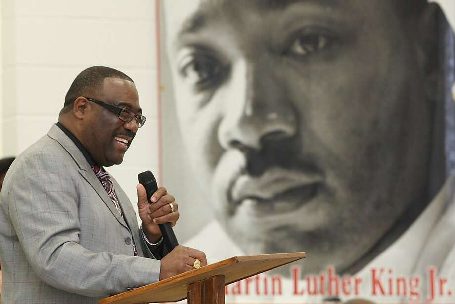 Pastor James L. Smith introduces the next guest speaker during a celebration for the life and legacy of Dr. Martin Luther King Jr. held at Palmer Grover Baptist Church in Kingston, N.C., on Sunday, Jan. 15, 2012. (AP Photo/The Star, Ben Earp) Photo: Ben Earp, Associated Press