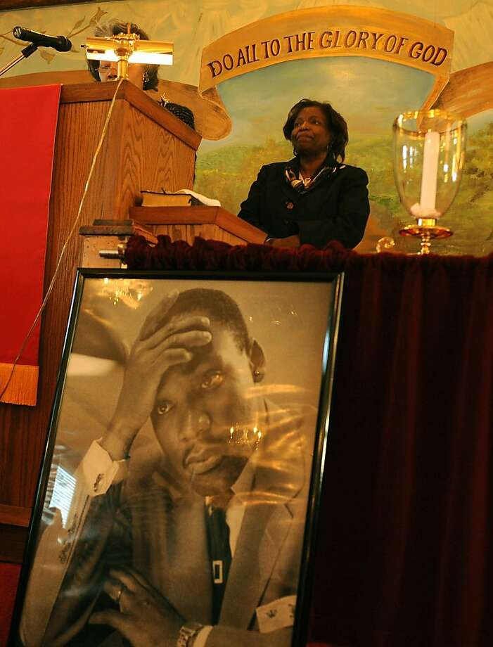 President Mildred D Middlebrooks of the Waynesboro NAACP stands behind a portrait of Dr. Martin Luther King Jr. during the service on Sunday, Jan. 15, 2012 at St. James Baptist Church in Waynesboro, Va. The church was near capacity on Sunday, Jan. 15, 2012 for the 24th annual celebration of Dr. Martin Luther King Jr. presented by the Waynesboro chapter of the National Association for the Advancement of Colored People. (AP Photo/The Daily News Leader, Pat Jarrett) Photo: Pat Jarrett, Associated Press