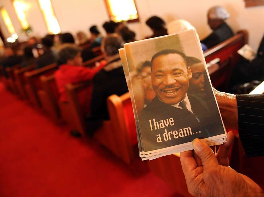 Publicity Chairman for the Waynesboro NAACP Calvin Johnson holds a program in a packed house on Sunday, Jan. 15, 2012 at St. James Baptist Church in Waynesboro, Va. St. James Baptist Church for the 24th annual celebration of Dr. Martin Luther King Jr. presented by the Waynesboro chapter of the National Association for the Advancement of Colored People. (AP Photo/The Daily News Leader, Pat Jarrett) Photo: Pat Jarrett, Associated Press