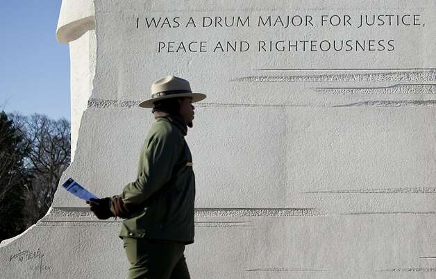 WASHINGTON, DC - JANUARY 15:  A park ranger walks past a paraphrased quote the National Parks Service plans to remove from the Martin Luther King Jr. memorial on the National Mall January 15, 2012 in Washington, DC.  Martin Luther King III and others joined to lay a wreath at the memorial to Rev. Dr. Martin Luther King Jr. to honor the 83rd birthday of the American Civil Rights leader who was assassinated in 1968.  (Photo by Brendan Smialowski/Getty Images) Photo: Brendan Smialowski, Getty Images