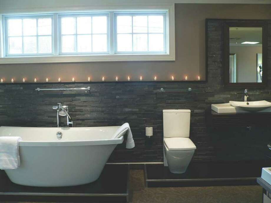 The classic soak tub, such as the Escale Freestanding Tub, is making a popular comeback. Enrich your experience even more with votive candles. Photo: Contributed Photo / Healthy Life