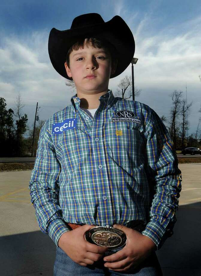 Large in part to his  rodeo abilities on a horse, Chance Little, 9, is featured in music video by the band Speed. Little has won numerous awards during his short time in the rodeo.  Photo taken Thursday, December 12, 2012 Guiseppe Barranco/The Enterprise Photo: Guiseppe Barranco, STAFF PHOTOGRAPHER / The Beaumont Enterprise
