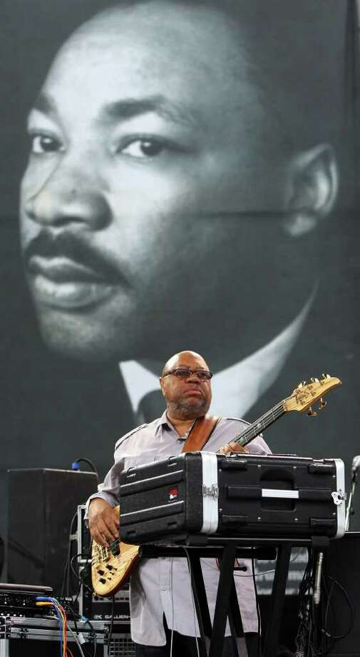Gregory Givens of the musical group Minister Lee & Co. warms up on the stage Monday January 16, 2012 before the Martin Luther King Day celebration at Pittman Sullivan Park. Photo: JOHN DAVENPORT, SAN ANTONIO EXPRESS-NEWS / SAN ANTONIO EXPRESS-NEWS (Photo can be sold to the public)