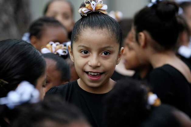 Iridian Lozano, 8, and other members of the MLK Praise Dance group get ready to perform before the start of the Martin Luther King, Jr., 25th annual Commemorative March, Monday, Jan. 16, 2012. Photo: JERRY LARA, San Antonio Express-News / SAN ANTONIO EXPRESS-NEWS