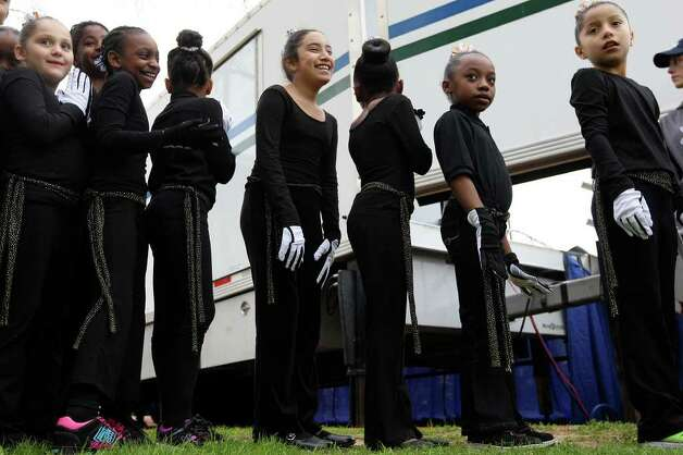 Members of the MLK Praise Dance group get ready to perform before the start of the Martin Luther King, Jr., 25th annual Commemorative March, Monday, Jan. 16, 2012. Photo: JERRY LARA, San Antonio Express-News / SAN ANTONIO EXPRESS-NEWS