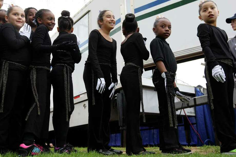 METRO -- Members of the MLK Praise Dance group get ready to perform before the start of the Martin Luther King, Jr., 25th annual Commemorative March, Monday, Jan. 16, 2012. JERRY LARA/glara@express-news.net Photo: JERRY LARA, San Antonio Express-News / SAN ANTONIO EXPRESS-NEWS